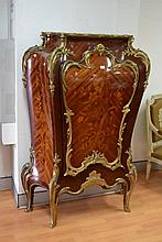 Exceptional French bombe shaped tall pedestal cabinet, inset rouge marble top, inlaid finely worked