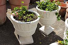 Two urn style garden planters with geraniums (2)
