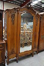 Fine antique French Louis XV breakfront three door armoire, single mirrored central door flanked by
