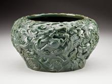 JADE BOWL CARVED WITH RUNNING BANDS OF DRAGONS