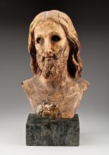 A CARVED FRAGMENTARY WOODEN BUST OF CHRIST