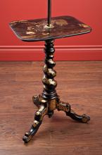 A BLACK LACQUERED ASIAN INFLUENCED FLOOR LAMP