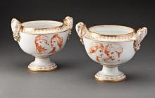 PAIR OF 19TH CENTURY PORCELAIN FOOTED URNS