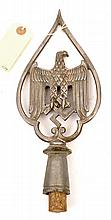 A Third Reich rough cast aluminium banner top, in the form of an eagle and
