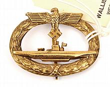 A Third Reich U boat badge of hollow die struck gilt brass with thin vertic