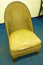 LLOYD LOOM GOLD FINISH UPHOLSTERED LOW CHAIR