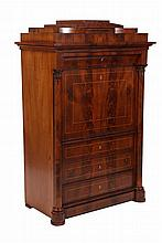 A Continental mahogany secretaire abbatant, 19th Century, the stepped architectural top over a shaped frieze drawer above a fall, enclosing drawers and a cupboard door with columns, over three graduated drawers, all between half columns continuing to