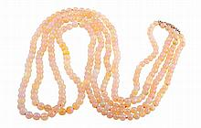 A double row necklace of opal beads, the two hundred and ninety two graduating opal beads strung simply into two rows on a pierced detail integral tongue clasp and figure of eight safety catch, set to the centre with a single old brilliant cut collet