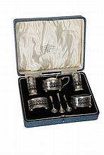 A George V silver cruet set, Northern Goldsmiths Co, Birmingham 1921/22, in a fitted case with associated spoons.