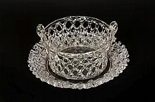 A Victorian glass chestnut basket and underplate, circular with pierced lattice type sides, the underplate with crimped moulding and pierced rim. Diameter of underplate 24.5cm