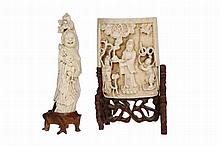 A Chinese ivory table screen, 19th Century, the bowed screen carved in deep relief with three figures standing on leaves, a bird overhead carrying a string of beads, the reverse engraved with a landscape and characters, in a carved and pierced wooden