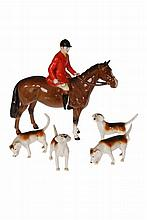 A Beswick model of a huntsman, brown gloss, model no. 1501; together with four Beswick models of hounds. (5)