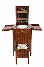 A fine George III mahogany and inlaid gentleman's dressing table, stamped Gillows Lancaster, the crossbanded top opening to reveal an adjustable rising mirror, two lidded bottle holders and cutouts for a basin and soap dishes, the jug cupboard with