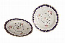 A pair of Derby dessert plates, c.1780, painted with floral sprays, probably by Withers, within a blue and gilt rim border, blue N over crown D mark. 23cm