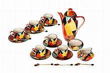 A Grays Pottery coffee service, designed by Susie Cooper, c. 1928, comprising coffee pot, six coffee cans and saucers, cream jug and sugar bowl, each piece hand painted to pattern no. 8127H with geometric overlapping triangles; together with a set of