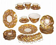 A Coalport tea service, late 19th Century, comprising ten tea cups and twelve saucers, eleven tea plates, two sandwich plates, cream jug (a/f) and slop bowl, green printed factory mark. (37)
