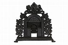 A Victorian cast iron chimney ornament, cast as a range. 32.5cm wide
