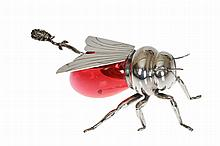 A Victorian silver plated and cranberry glass novelty honey pot, Mappin & Webb, in the form of a bee, the wings hinged to form a cover, with associated spoon. 16cm