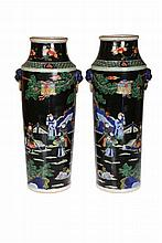 A pair of Chinese Famille Verte vases, of shouldered tapering cylindrical form, moulded with mask ring handles, enamel painted with figures. 42.5cm