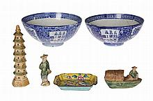 A Cantonese enamel shallow dish, painted with peach blossom and butterfly, 10cm by 7cm; together with a pair of Chinese blue and white bowls, each densely painted with scrolls and foliage, (a/f); a Chinese glazed earthenware model of a pagoda and two