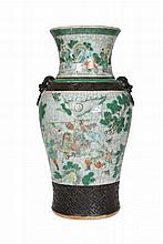 A Chinese crackle glazed vase, 19th/20th Century, of shouldered ovoid form with flared neck and moulded mask ring handles, enamel painted with figures. 36cm