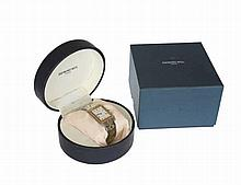 A gentleman's three tone metal wristwatch, signed Raymond Weil, Geneve, Parsifal, the rectangular case with conforming dial with Roman numerals and date calendar, in a case and box with certificate of authenticity. Case 4mm by 3mm