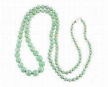 A jadeite necklace, the one hundred and twenty graduating jadeite beads strung knotted on to a rectangular integral tongue clasp. Stamped 9CT. Total length approximately 80cm. Total weight approximately 44.1gms.