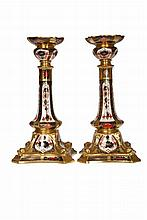 A pair of Royal Crown Derby Imari candlesticks, each decorated to pattern no. 1128, red printed factory marks, each with box. 27cm