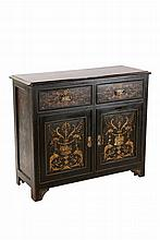 An Aesthetic ebonised, scumbled and painted side cabinet, the moulded rectangular top with rounded corners over a pair of frieze drawers above a pair of cupboard doors, all decorated with formal ornament and fitted with sunflower cast brass handles,