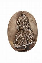 A silver portrait medallion of Charles I, oval, unmarked, his bust left, inscribed CAROLUS REX. 11cm by 8cm