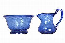 A late Georgian blue wrythen glass cream jug and sugar bowl, c. 1800. Diameter of sugar bowl 12cm