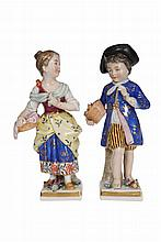 A pair of Naples porcelain figures, late 19th Century, modelled as a boy and girl in 18th Century dress, underglaze blue crowned N marks, 13cm; together with a Staffordshire model of a poodle, modelled with a shredded coat. (3)