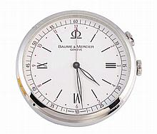 A stainless steel travel clock, signed Baume & Mercier, Geneve, the circular case with easel back, numbered verso 5302845 and 65568, in a signed pouch and with tag. 5.5cm