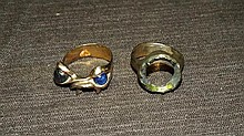 Two 14 Kt yellow gold ring settings.