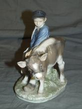 Royal Copenhagen Figurine. Boy with Calf,