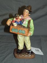 Royal Doulton Figurine. The Organ Grinder