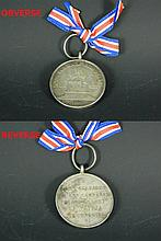 A medal dated 1895