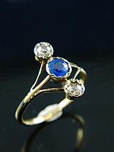 A sapphire & diamond three stone ring