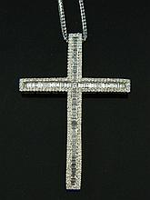 A diamond set cross on a gold chain