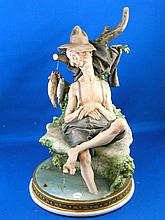 A Capodimonte figure depicting a tired fisherman