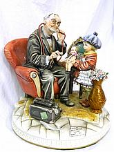 A Capodimonte figure depicting a doctor examining
