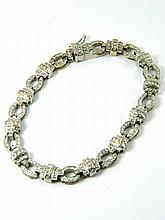 A diamond line bracelet set in 18ct gold