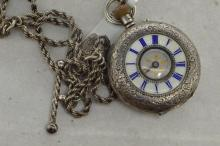 Ladies' silver pocket watch with fancy silver chain