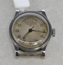 Gentlemen's military Longines wristwatch, circular dial with natural patina, original blued hands, outer minute track, Arabic numerals, Longines signed 16 jewel movement, caseback signed D.E ELFORD, Devon Regt 7-9-39. Circa 1940s