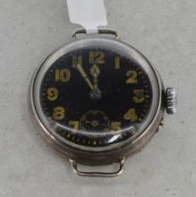 Silver cased military trench wristwatch, circular black dial dial with gold coloured bold Arabic numeral hour markers, subsidiary dial situated at six o'clock, inlaid luminous hands, oversized crown, Swiss made manual movement