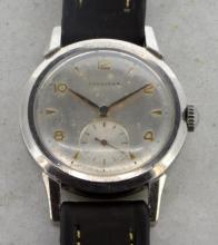 Gentlemen's Longines wristwatch, circular silver coloured dial, gold plated alternating Arabic numerals at hour markers, subsidiary dial at six o'clock, screwdown caseback, Longines signed manual movement, black leather strap