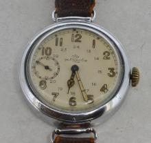Gentlemen's oversized military trench wristwatch, circular white dial, applied luminous Arabic numerals, inlaid hands, subsidiary dial at nine o'clock, brown leather strap