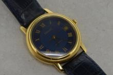 18ct yellow gold gentlemen's Tissot automatic, circular blue dial with applied Roman numerals, date appratute situated at three o'clock, engine turned bezel, display caseback revealing a 21 jewel Swiss ETA calibre No. 2892A2, dark blue leather crocodile grain strap and Tissot signed buckle
