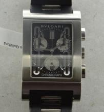 *Gentlemen's Bvlgari Rettangolo chronograph wristwatch, rectangular black dial, date aperture situated within six o'clock subsidiary dial, stainless steel case, Bvlgari signed Swiss quartz movement, rubber/stainless steel signed bracelet, signed deployment style clasp (Lot subject to VAT)