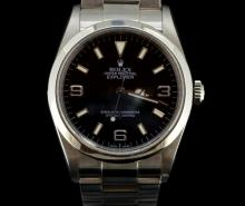 Gentlemen's Rolex Explorer 1 wristwatch, model 114270, circular black dial with applied luminous baton hour markers and Arabic quarters, polished Mercedes hands with luminous inserts, brushed and polished tonneau shaped case with screw down Oyster caseback and crown, brushed finish to Oyster lock 78690 bracelet. Y79**** serial and circa 2002
